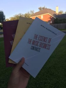big mansion music business books in hand
