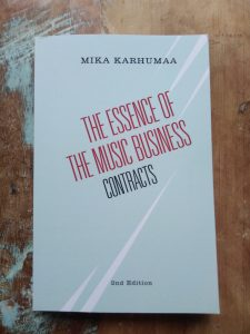 music business book on top of stool made of teak